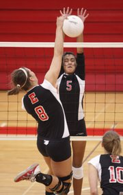 Lawrence High freshman Caitlin Broadwell (5) jumps to block a spike by Emporia High senior Courtney Waldner. The Lions swept Emporia, but lost to Blue Valley North on Tuesday at Lawrence High.