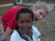 "Curtis Zicker is seen in Ethiopia with Hagos, whose name means ""happy."""