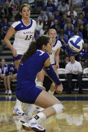 Melissa Manda digs for the bump as Kansas went against Texas.