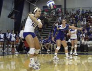 Brianne Riley (10) gets the bump on the serve as Kansas went against Texas Wednesday, Oct. 20, 2010, at Horejsi Center.
