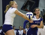 Kansas' Morgan Boub, left, gets an arm on the ball against Texas.