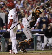 San Francisco Giants catcher Buster Posey reacts after Philadelphia Phillies' Ryan Howard (6) strikes out to end the NLCS. The Giants won the game, 3-2, on Saturday in Philadelphia to advance to the World Series.