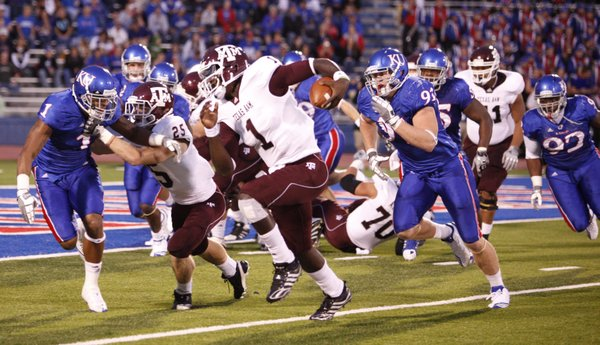 Kansas safety Lubbock Smith (1) can't catch Texas A&M quarterback Jerrod Johnson (1) as he runs to the endzone for a touchdown during the first quarter Saturday, Oct. 23, 2010 at Kivisto Field.