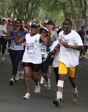 66-year-old Orah Bessit, foreground left, participates in a road race Sept. 16 in Johannesburg. Bessit, who grows her own vegetables, walks and runs, recognizes that staying healthy requires sacrifices, so she has given up hamburgers and switched from white bread to whole-grain. A growing urban middle class is defying the image of Africa as poor, underfed and under-medicated. And with the comforts of middle-class life, afflictions familiar in the West are making inroads here too: obesity, diabetes, lung cancer, strokes, heart disease.