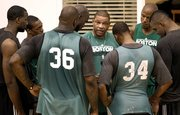 Boston Celtics coach Doc Rivers, center,  talks with players, from left, Kendrick Perkins, Rajon Rondo, Shaquille O'Neal (36), Kevin Garnett, Paul Pierce (34), Ray Allen and Glen Davis during practice Monday in Waltham, Mass. The Celtics will open the season today against Miami.