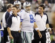 Dallas Cowboys quarterback Tony Romo leaves the field during the second quarter against the New York Giants after suffering a broken collarbone. The Cowboys ultimately lost to the Giants, 41-35, Monday in Arlington, Texas.