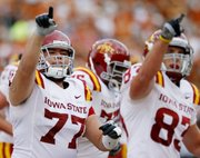 Iowa State players Alex Alvarez, left, and Jake Williams celebrate a play during the first half of ISU's 28-21 victory Saturday over Texas in Austin, Texas.