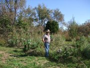 Steve Moring, of Oskaloosa, stands in his suntrap garden full of produce. Moring is an experienced permaculture farmer.