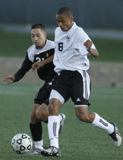 Free State high senior midfielder Preston Newsome (8) works for control against Topeka High forward Luis Blanco. The Firebirds fell, 1-0 in double overtime, on Tuesday at FSHS.