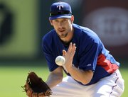 Texas Rangers pitcher Cliff Lee fields a hit during baseball pitching drills on Sunday in Arlington, Texas. Lee will start Game 1 of the World Series for the Rangers tonight against the Giants in San Francisco.
