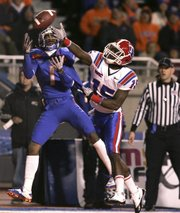 Boise State's Titus Young (1) goes up for a pass against Louisiana Tech's Josh Victorian (15). The pass was incomplete Tuesday in Boise, Idaho.