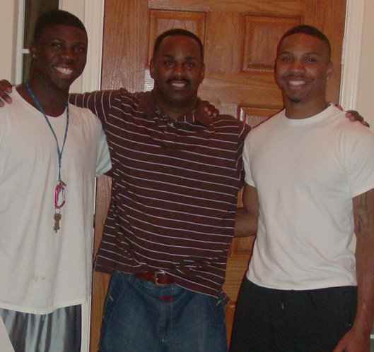 Lubbock Smith, right, is shown with current Texas A&M football player Cyrus Gray, left, and godfather Willie Weeks. Gray and Smith were teammates during youth football in Dallas.