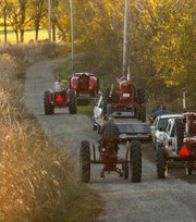 Friends of John Pierson helped load and move dozens of his antique tractors Wednesday.