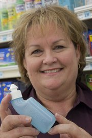Jan Hornberger, health market manager at Hy-Vee, 3504 Clinton Parkway, recommends a neti pot product like Nasopure