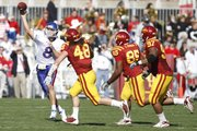 Kansas quarterback Quinn Mecham throws as he is chased by Iowa State defenders Jacob Lattimer (48), Bailey Johnson (85) and Stephen Ruempolhamer (97) during the second quarter Saturday, Oct. 30, 2010 at Jack Trice Stadium.