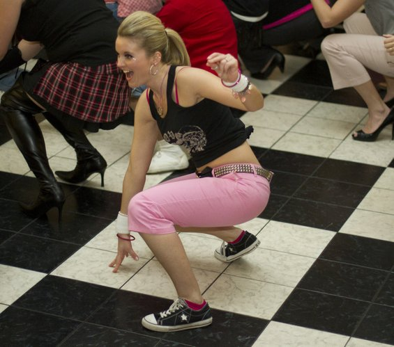 Erica Bulmer, Lawrence, gets down and groovy on the dance floor during the Stepping Out Against Breast Cancer dance.