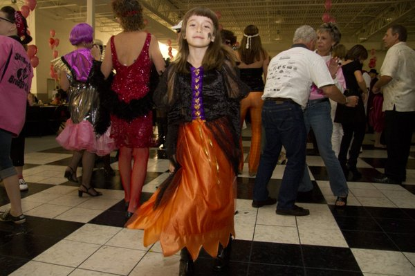 Jaclyn Landers, 8, Lawrence, gets her groove on at the 2010 Stepping Out Against Breast Cancer Dance held Oct. 30 at Crown Automotive, 3400 Iowa. For more photos, visit WellCommons.com.