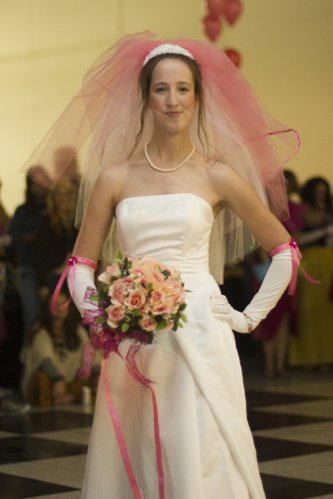 Elizabeth Pekrul, Lawrence, models a wedding dress as part of a fashion show skit by the LMH surgery department.