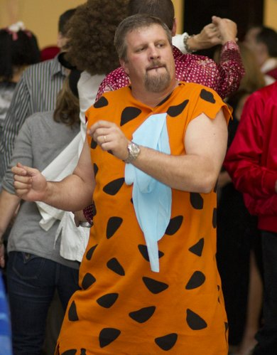 Tom Haymaker, Olathe, gets his groove on, dressed as Fred Flintstone.