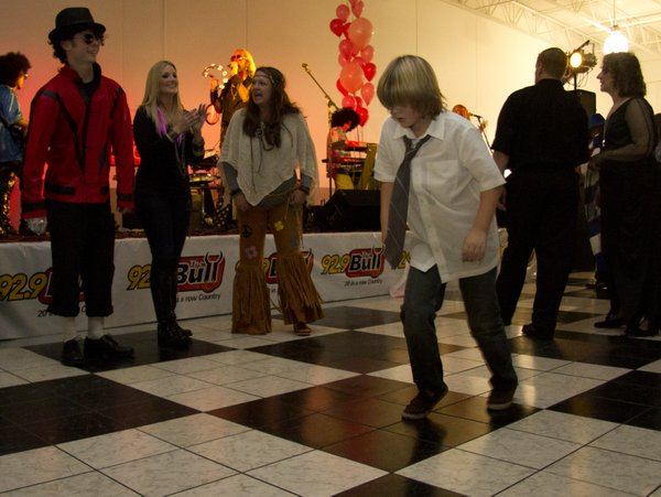 Isaac Erwin, 10, Topeka, shows Michael Jackson how to moonwalk.