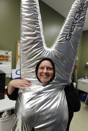 At the Great Clips hair salon, Jenny Bagwell shows her scissors outfit, which she wears about 12 hours a week to attract potential customers in Maple Grove, Minn.