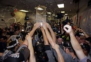 The San Francisco Giants celebrate after winning the World Series. The Giants defeated the Texas Rangers, 3-1, in Game 5 on Monday in Arlington, Texas.