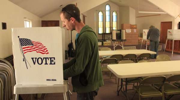 Aaron Chavers, Lawrence, votes just after 1 p.m. Tuesday at the Central United Methodist Church at 1501 Mass. At the time Chavers cast his ballot, 160 had voted at that precinct so far.