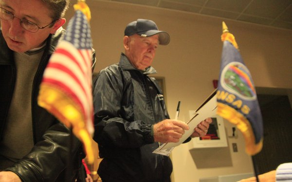 Connie Skinner looks over his ballot at the Union Pacific depot in Lawrence on Tuesday, Nov. 2, 2010. Skinner was the first voter to cast his ballot at the depot on election day.