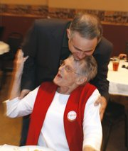 Republican Tim Huelskamp gets a hug from supporter, Joyce Knott, of Plains, Kan., at the watch party in Dodge City, Kan. He is running for the Kansas 1st District Congress Tuesday, Nov. 2, 2010.