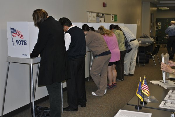 Voters fill out their ballots just before polls close at Free State High School on November 2, 2010.