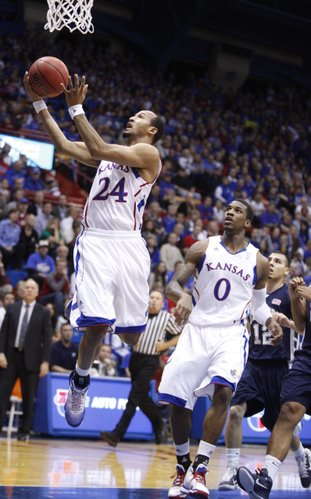 Kansas guard Travis Releford tries to adjust for a bucket after being fouled by a Washburn defender in the first half of the exhibition game, Tuesday, Nov. 2, 2010 at Allen Fieldhouse.