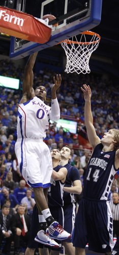 Kansas forward Thomas Robinson puts a shot off the glass over Washburn forward Logan Stutz (14) in the first half of the exhibition game, Tuesday, Nov. 2, 2010 at Allen Fieldhouse.