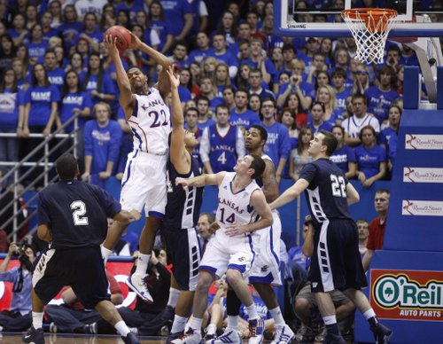 Kansas forward Marcus Morris pulls a rebound away from a pile of Jayhawks and Icabods in the first half of the exhibition game, Tuesday, Nov. 2, 2010 at Allen Fieldhouse.
