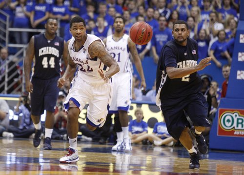Kansas forward Marcus Morris chases down a loose ball after stripping it from Washburn forward De'Andre Washington in the first half of the exhibition game, Tuesday, Nov. 2, 2010 at Allen Fieldhouse. Washburn's Virgil Philistin was called for an intentional foul on the ensuing drive to the bucket for wrapping up Morris.