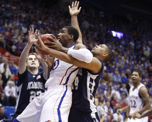 Kansas forward Thomas Robinson tangles with Washburn players Alex North (22) and Zack Riggins (24) in the first half of the exhibition game, Tuesday, Nov. 2, 2010 at Allen Fieldhouse.