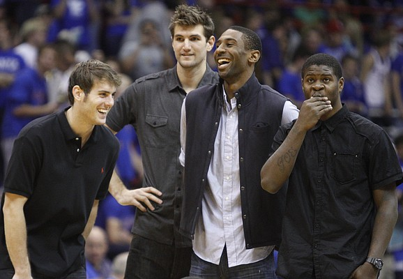 Kansas players Conner Teahan, left, Jeff Withey, Justin Wesley and Josh Selby laugh as they watch warmups prior to tipoff against Washburn, Tuesday, Nov. 2, 2010 at Allen Fieldhouse.