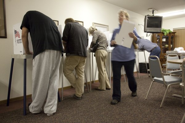 Voters at Drury Place Apartments fill out ballots during late afternoon voting Tuesday, Nov. 2, 2010.