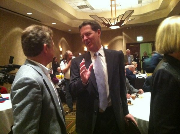 Sam Brownback speaks with friends before his speech in Topeka on Nov. 2, 2010 just before being elected Kansas governor.
