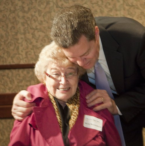 Sen. Sam Brownback hugs his mother Gina Brownback, Parker, during a GOP Clean Sweep party Tuesday, Nov. 2, 2010 in Topeka. Brownback defeated Tom Holland of Baldwin City in the gubernatorial race.