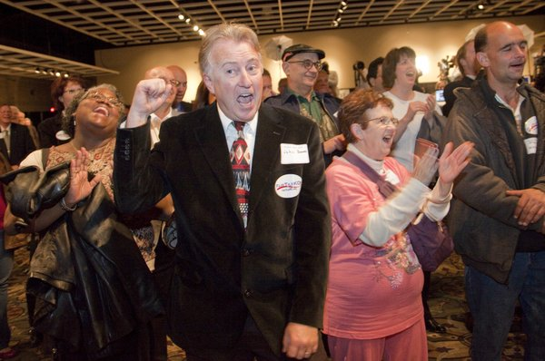 John Bowes, Topeka, center, joins other Republican supporters cheering during a speech by Sen. Pat Roberts during a GOP Clean Sweep party Tuesday, Nov. 2, 2010 in Topeka.