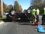 Emergency crews treat a patient at the scene of an injury accident on 23rd and Massachusetts streets on Wednesday, Nov. 3, 2010.