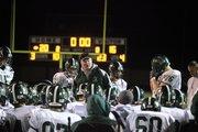 Free State Coach Bob Lisher talks to his Firebirds after a disappointing loss to Olathe East on Friday November 5, 2010