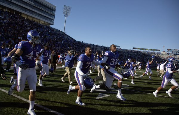 The Jayhawks race onto the field following their 52-45 comeback victory over Colorado, Saturday, Nov. 6, 2010 at Kivisto Field.