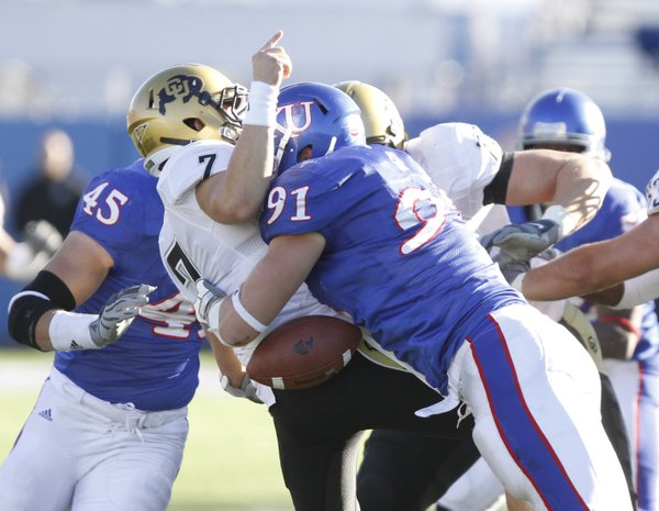 Kansas defensive end Jake Laptad knocks the ball loose from Colorado quarterback Cody Hawkins during the fourth quarter, Saturday, Nov. 6, 2010 at Kivisto Field. The fumble was recovered by Colorado.