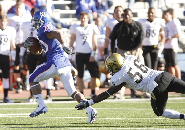 Kansas receiver D.J. Beshears escapes a tackle by Colorado cornerback Derrick Webb during the fourth quarter, Saturday, Nov. 6, 2010 at Kivisto Field.