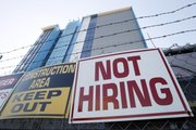 A sign turning away potential job-seekers is seen Nov. 4 outside of a construction site in New Orleans. Employers added the most jobs in five months in October, with the education and health care sectors leading the way.