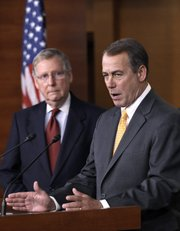 House Republican leader John Boehner of Ohio, right, with Republican Senate Minority Leader Mitch McConnell of Ky., speaks at a news conference Wednesday on Capitol Hill in Washington.