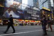 "A building-sized banner covers the front of the Foxwoods Theater on 42nd street Oct. 5 in New York. Producers of ""Spider-Man Turn Off the Dark"" are delaying by three weeks the opening of the costly and complicated show."