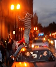 Motorists in Oakland, Calif., react as demonstrators jump on their car Friday following the sentencing of Johannes Mehserle. Mehserle, a former police officer who fatally shot unarmed black man Oscar Grant on New Year's Day 2009, received a two-year prison sentence.