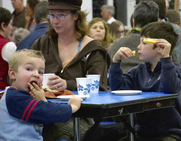Sebastian Simpson-Eighmy enjoys a treat Saturday evening during a community dinner at West Junior High School.